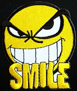 Smiley Evil Smile iron-on / sew-on cloth patch    (tg)